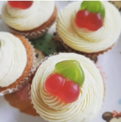 Glutenfree vanilla cupcake with buttercream and a vegetarian gluten free cherry sweetie