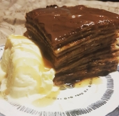 Gluten free chocolate pancake cake with vegan ice cream
